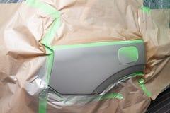 Pittura parziale del cuscino ammortizzatore e dell'ala laterali dell'elemento con la falda del serbatoio di combustibile del corp fotografie stock