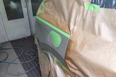 Pittura parziale del cuscino ammortizzatore e dell'ala laterali dell'elemento con la falda del serbatoio di combustibile del corp fotografia stock libera da diritti