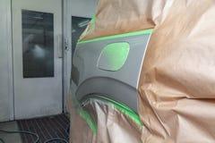 Pittura parziale del cuscino ammortizzatore e dell'ala laterali dell'elemento con la falda del serbatoio di combustibile del corp immagine stock
