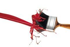 Pittura rossa che spruzza sul painbrush Fotografie Stock Libere da Diritti