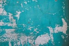 Pittura scheggiata su un vecchio fondo di struttura della parete del gesso Fotografia Stock
