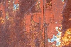 Pittura scheggiata sul fondo di struttura della superficie del ferro Immagini Stock
