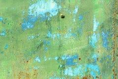 Pittura scheggiata sul fondo di struttura della superficie del ferro Fotografia Stock