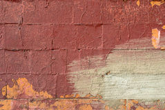 Pittura scheggiata sul vecchio fondo di struttura del muro di cemento Fotografia Stock