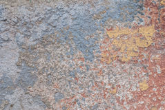 Pittura scheggiata sul vecchio muro di cemento, fondo di struttura Immagine Stock Libera da Diritti