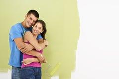 Pittura sorridente delle coppie. Fotografie Stock Libere da Diritti