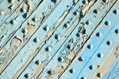 pittura spogliata sporca nel chiodo blu fotografia stock