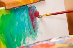 Pittura su un cavalletto Immagini Stock