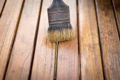 Pittura sul primo piano di legno della tavola Fotografia Stock