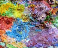 Pitture ad olio di miscelazione su una tavolozza Immagine Stock