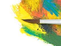 Pitture di colore e della spazzola su bianco fotografia stock