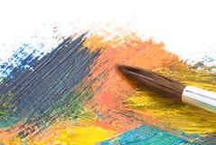 Pitture di colore e della spazzola su bianco fotografie stock