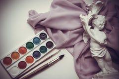Pitture di Waterciolor su drappi con le spazzole Fotografia Stock