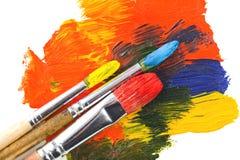 Pitture e spazzole immagine stock