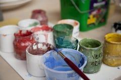 Pitture e spazzole fotografie stock