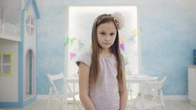 Pity little girl posing in front of the camera stock video footage