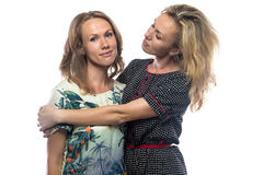 Pitying blond mother and daughter Stock Photo