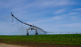Pivot irrigation system operating with water Stock Image