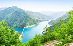 Pivsko Jezero, Montenegro. Nice panorama view of blue sea, mountains and bridge. Pivsko Jezero, Montenegro Stock Photo