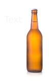 Piwna butelka odizolowywająca na bielu Fotografia Royalty Free