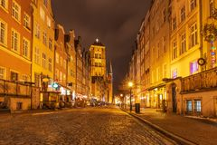 Piwna street and view on the St Mary`s Basilica Tower in Gdansk, Poland, evening, no people stock image
