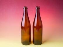 Piwnych butelek tła kolory. Zdjęcie Royalty Free