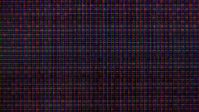 Pixéis do RGB na tevê durante a seleção do filme, macro, close-up video estoque