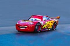 Pixar Cars Lighting McQueen. Pixar character is set against blue background. The Pixar animated movie CARS featured the race car character Lighting McQueen stock photos