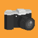 Pixel art camera. Pixel art of photographic camera with lens. Isolated vector icon illustration Stock Images