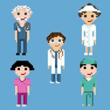 Pixel art characters of doctors and nurses. A set of five pixel people isolated on a blue background stock illustration