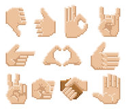 Pixel Art Hand Icons. A set of 8 bit pixel art hand icons Royalty Free Stock Images