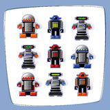 Pixel Art Robot Icons. Colorful, pixel art robot icons with cast shadow. Easy-edit vector file Stock Image