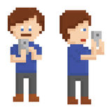 Pixel art young person taking a picture on smart Royalty Free Stock Photography