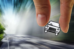 Pixel car icon. Close up of hand picks pixel car icon on blur background Stock Images