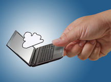 Pixel cloud icon as concept. Close up of hand hold laptop and pixel cloud icon as concept Stock Photo