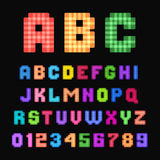 Pixel font. Colorful pixel font isolated on black background Royalty Free Stock Photography