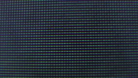 Pixel infiammanti dello schermo della TV video d archivio