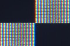 Pixel-level detail of real RGB LCD screen. Detail/macro of pixels on a real LCD monitor with square pixels and RGB pixel order. Includes four rectangles -two Stock Image