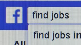 Close Up user types the words `find jobs` into search bar on Facebook. Pixel level macro view as user types the words `find jobs` into search bar on Facebook * stock video