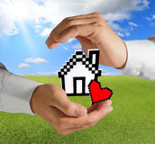 Pixel love house. Business hands show pixel love house as concept Stock Photo