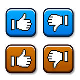 Pixel thumb up and down buttons Stock Images