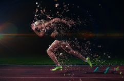 Pixelated design of woman  sprinter leaving starting blocks Stock Photos