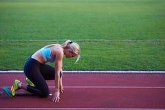 Pixelated design of woman  sprinter leaving starting blocks Stock Photos