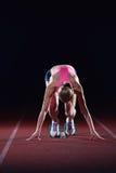 Pixelated design of woman  sprinter leaving starting blocks Royalty Free Stock Image
