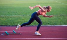 Pixelated design of woman  sprinter leaving starting blocks Stock Image