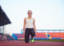 Pixelated design of woman  sprinter leaving starting blocks Royalty Free Stock Photos