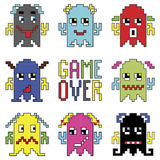 Pixelated robot emoticons with game over sign inspired by 90's computer games showing different emotions. Icons set Royalty Free Stock Photos
