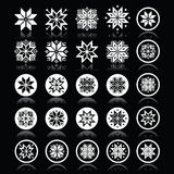 Pixelated snowflakes, Christmas white icons on black Stock Photos