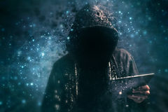 Pixelated unrecognizable hooded cyber criminal Stock Photo