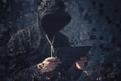 Pixelated unrecognizable hooded cyber criminal Stock Photography